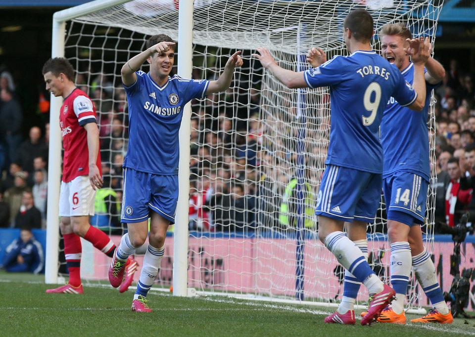 Photo - Chelsea's Oscar, 2nd left, celebrates after scoring his side's 4th goal of the game during their English Premier League soccer match between Chelsea and Arsenal at Stamford Bridge stadium in London, Saturday, March,  22,  2014. (AP Photo/Alastair Grant)