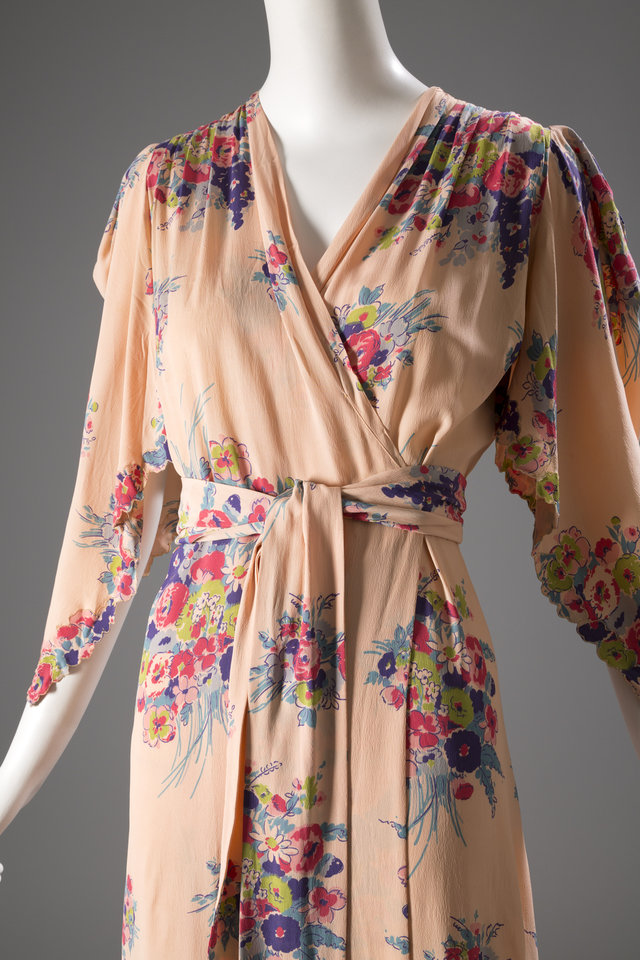 Photo - This image released by The Museum at FIT shows a lounging robe in printed rayon, a U.S. garment, circa 1942, from Jay Thorpe.  From a 1770 corset to a 2014 bra-and-panty set in lacy stretch silk, the Museum at the Fashion Institute of Technology has taken on lingerie and ladies foundation garments as the focus of a new exhibition. In about 70 pieces,
