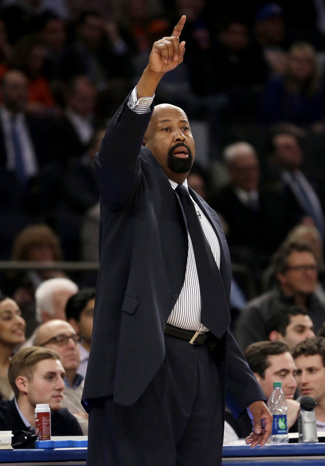 Photo - New York Knicks coach Mike Woodson gestures to his team during the second half of an NBA basketball game against the Indiana Pacers at Madison Square Garden, Wednesday, March 19, 2014, in New York. The Knicks defeated the Pacers 92-86. (AP Photo/Seth Wenig)