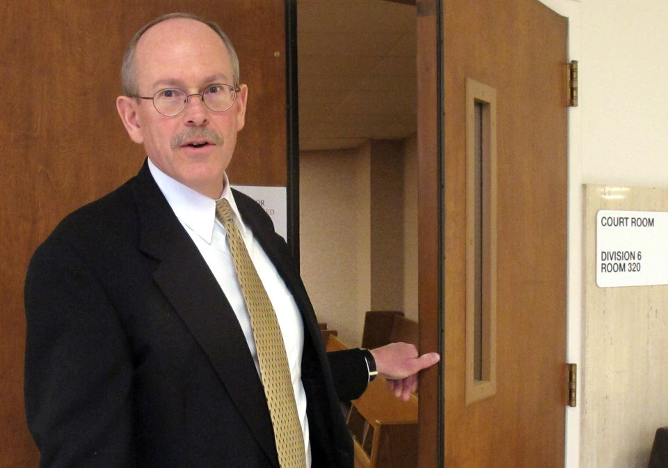"""Kirk Thompson, director of the Kansas Bureau of Investigation, leaves a Shawnee County courtroom Tuesday in Topeka, Kan., after a judge ruled in favor of the KBI in a dispute over records retained by a deceased agent from the 1959 multiple murder case that inspired Truman Capote's book, """"In Cold Blood.""""  (AP Photo)"""