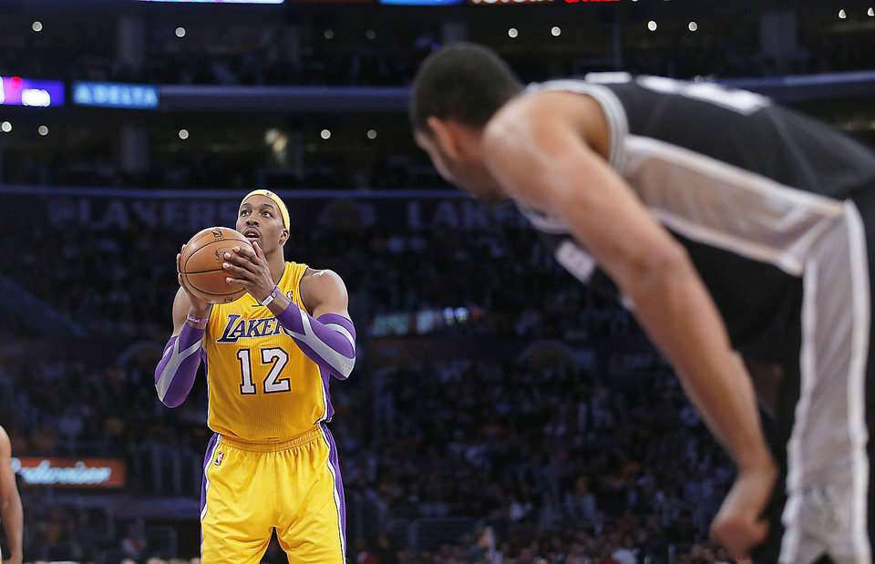 Los Angeles Lakers' Dwight Howard shoots a free throw in the second half of an NBA basketball game against the San Antonio Spurs in Los Angeles, Tuesday, Nov. 13, 2012. The Spurs won 84-82. (AP Photo/Jae C. Hong)