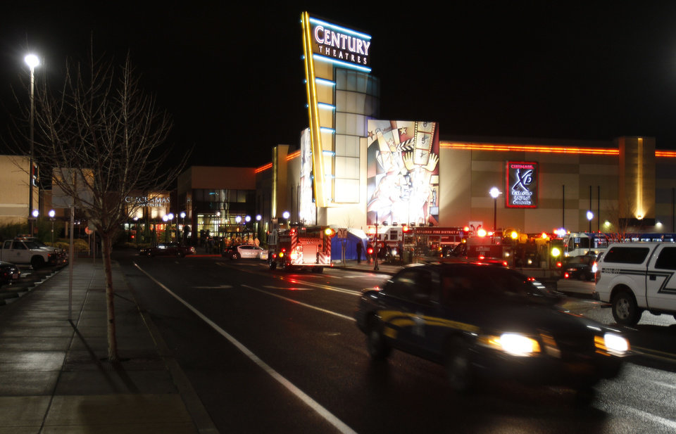 Photo - An Oregon State police car leaves the parking lot where a gunman opened fire at the Clackamas Town Center shopping mall earlier in Portland, Ore., Tuesday, Dec. 11, 2012.  Police say three people are dead, including the gunman. (AP Photo/Don Ryan)
