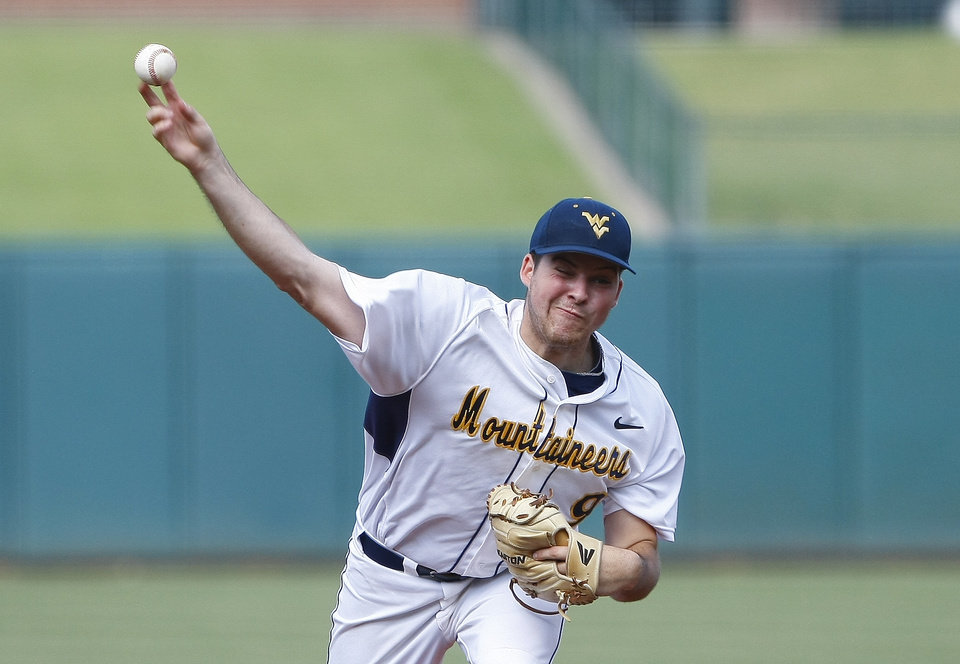 Photo - West Virginia starting pitcher Corey Walter throws in the first inning of a game against TCU in the Big 12 NCAA college baseball tournament in Oklahoma City, Thursday, May 22, 2014. (AP Photo/Alonzo Adams)