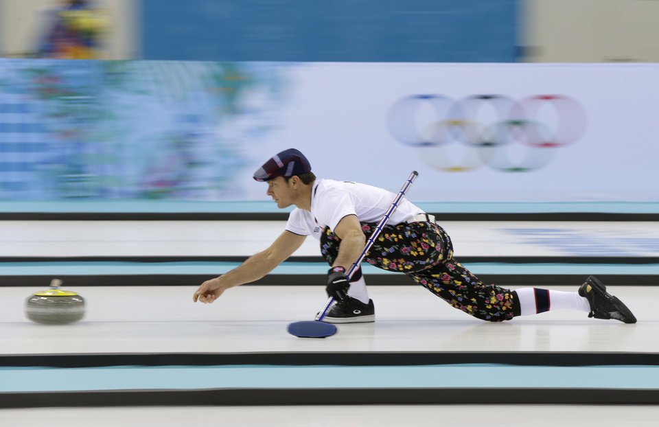 Photo - Norway skip Thomas Ulsrud, wearing rose-painting knickers and a patterned flat cap, delivers the stone during curling training at the 2014 Winter Olympics, Saturday, Feb. 8, 2014, in Sochi, Russia. (AP Photo/Robert F. Bukaty)