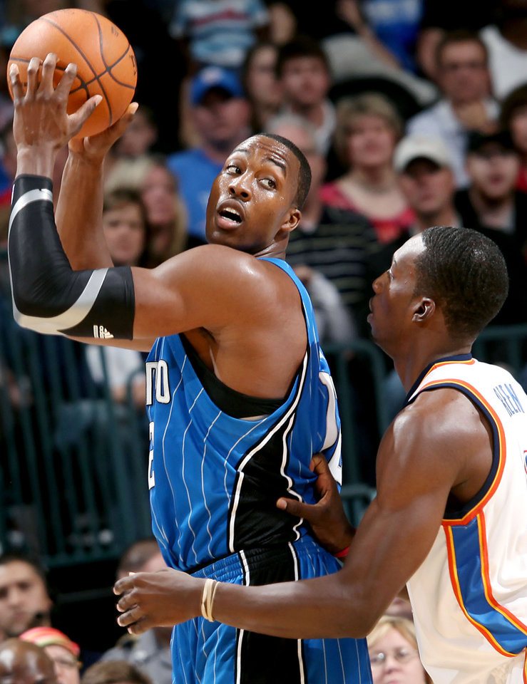 Orlando\'s Dwight Howard looks for room against Oklahoma City\'s Jeff Green during the NBA basketball game between the Orlando Magic and the Oklahoma City Thunder at the Ford Center in Oklahoma City, on Sunday, Nov. 8, 2009. By John Clanton, The Oklahoman