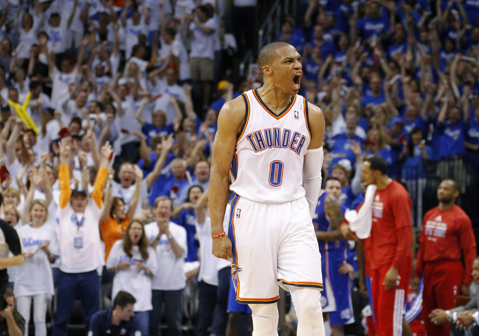 Photo - Oklahoma City's Russell Westbrook (0) celebrates a basket during Game 2 of the Western Conference semifinals in the NBA playoffs between the Oklahoma City Thunder and the Los Angeles Clippers at Chesapeake Energy Arena in Oklahoma City, Wednesday, May 7, 2014. Photo by Bryan Terry, The Oklahoman