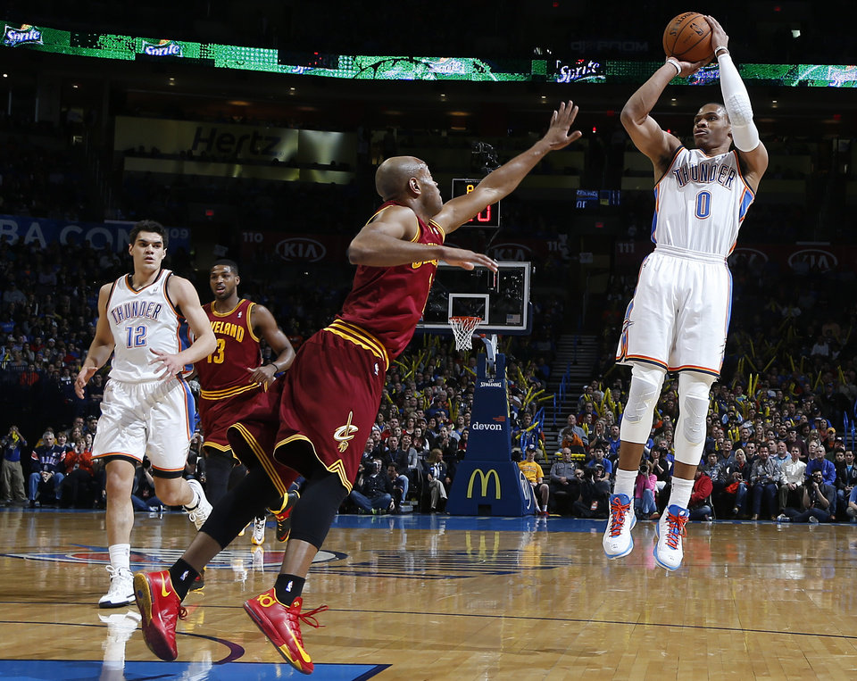 Photo - Oklahoma City's Russell Westbrook (0) shoots over Cleveland's Jarrett Jack (1) during the NBA basketball game between the Oklahoma City Thunder and the Cleveland Cavaliers at the Chesapeake Energy Arena in Oklahoma City, Okla. on Wednesday, Feb. 26, 2014.  Photo by Chris Landsberger, The Oklahoman