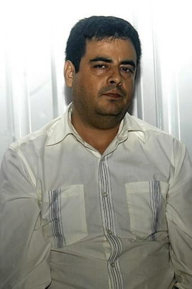 Photo - This photo released by Mexico's Federal Security Secretary Saturday, Jan. 2, 2010, shows  Carlos  Beltran  Leyva at an undisclosed location after his arrest. The Public Safety office says  Beltran  Leyva was arrested Wednesday, Dec. 30, 2009, in Culiacan, the capital of the Pacific coast state of Sinaloa where he and several of his brothers were born and started their gang. (AP Photo/Mexico Federal Security Secretary)