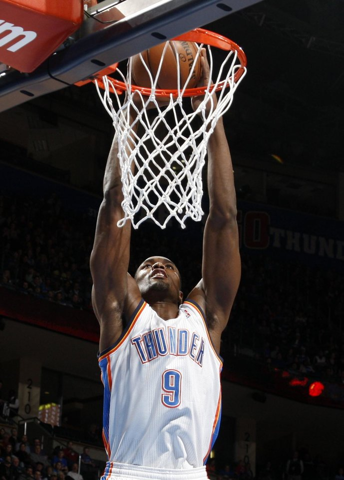 Oklahoma City\'s Serge Ibaka (9) dunks during the NBA basketball game between the Oklahoma City Thunder and the Memphis Grizzlies at the Chesapeake Energy Arena in Oklahoma City, Thursday, Jan. 31, 2013.Photo by Sarah Phipps, The Oklahoman