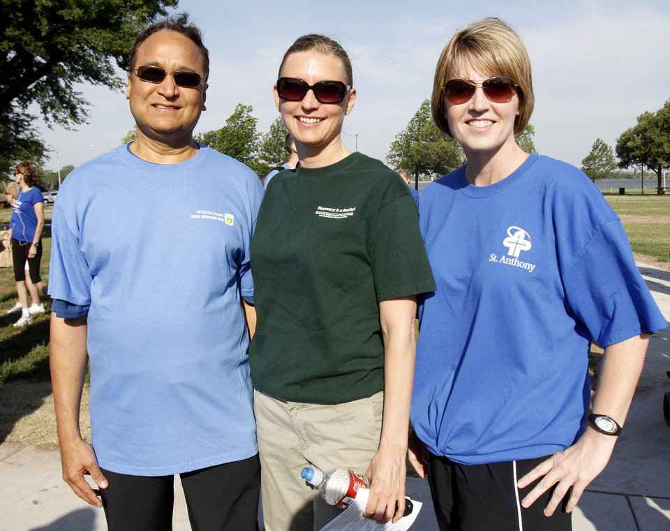 Photo - Dr. R. Murali Krishna, Terri White, Commissioner of the Oklahoma Dept. of Mental Health and Substance Abuse, and Tammy Powell, Saint Anthony Executive VP, participate in the NAMI (National Alliance on Mental Illness) walk at Stars and Stripes Park in Oklahoma City, OK, to raise money for mental illness causes, Saturday, May 19, 2012,  By Paul Hellstern, The Oklahoman