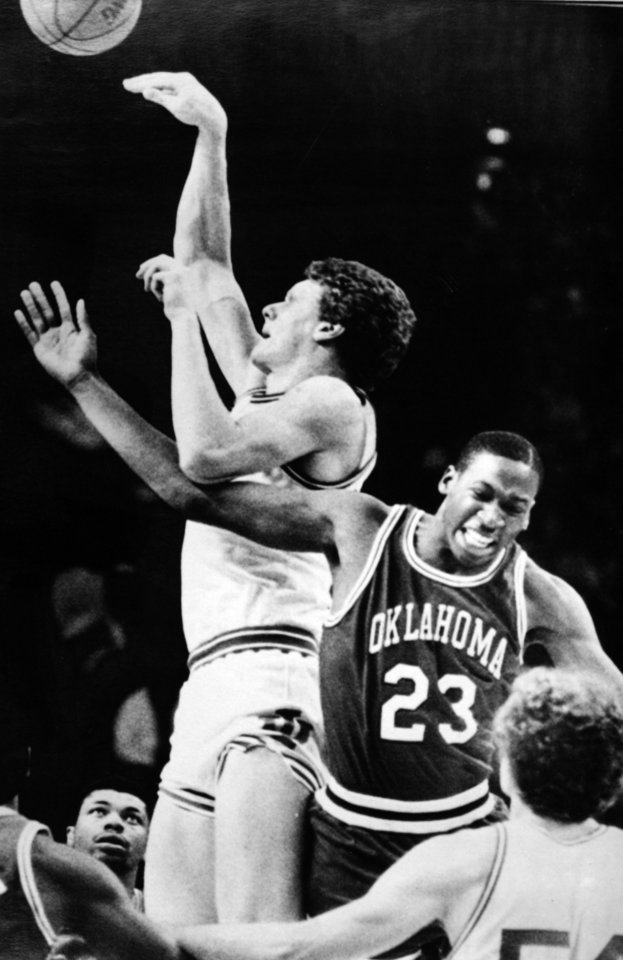 Photo - Former OU basketball player Wayman Tisdale. EVENSVILLE, Ind., Mar. 20 - HOOKING--Indiana's 7-foot-2 Uwe Blab hooks over Oklahoma's Wayman Tisdale (23) to score in the second round of the NCAA Mideast Regional in Evansville Sunday afternoon. Tisdale was called for a foul on the play. (AP LaserPhoto) 1983. Photo taken 3/20/1983, photo published 3/21/1983 in The Daily Oklahoman. ORG XMIT: KOD