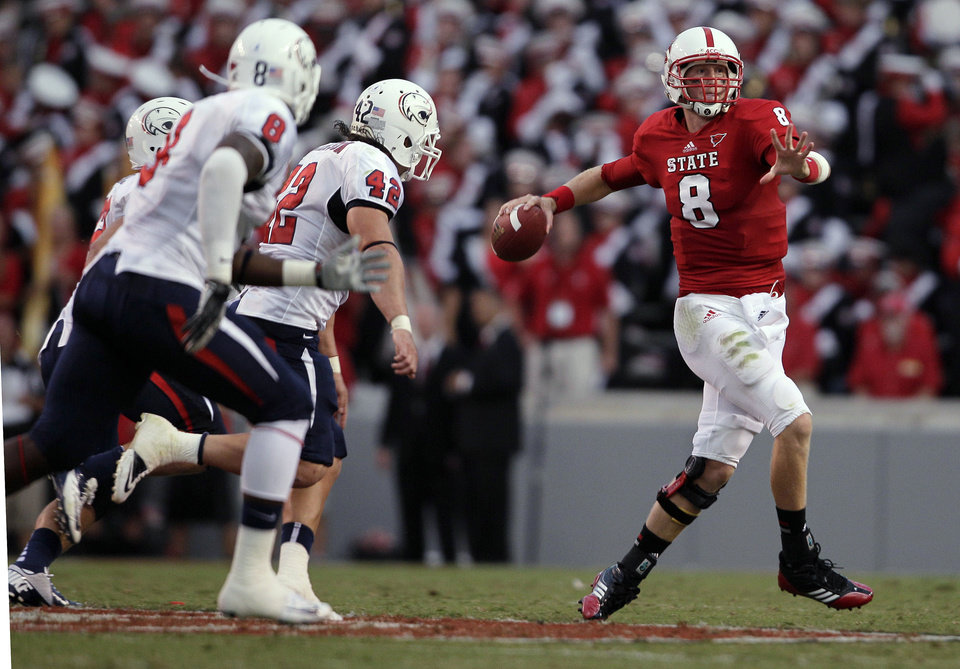 Photo -   North Carolina State quarterback Mike Glennon, right, passes as South Alabama's Bryant Lavender (8) and Jake Johnson (42) defend during the first half of an NCAA college football game in Raleigh, N.C., Saturday, Sept. 15, 2012. (AP Photo/Gerry Broome)