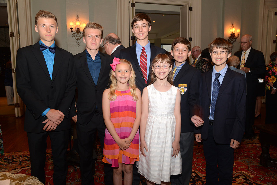 Photo -  Lars and Toren Reksnis, Christopher McElhaney, Henry McElhaney, Matthew Carey, back, and Liv Reksnis and Julia Carey, front.