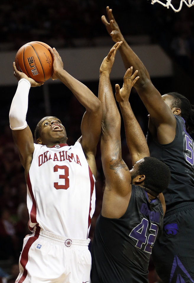 Photo - Oklahoma's Buddy Hield (3) shoots against Kansas State's Thomas Gipson (42) and D.J. Johnson (50) during an NCAA men's basketball game between the University of Oklahoma (OU) and Kansas State at the Lloyd Noble Center in Norman, Okla., Saturday, Feb. 2, 2013. Photo by Nate Billings, The Oklahoman
