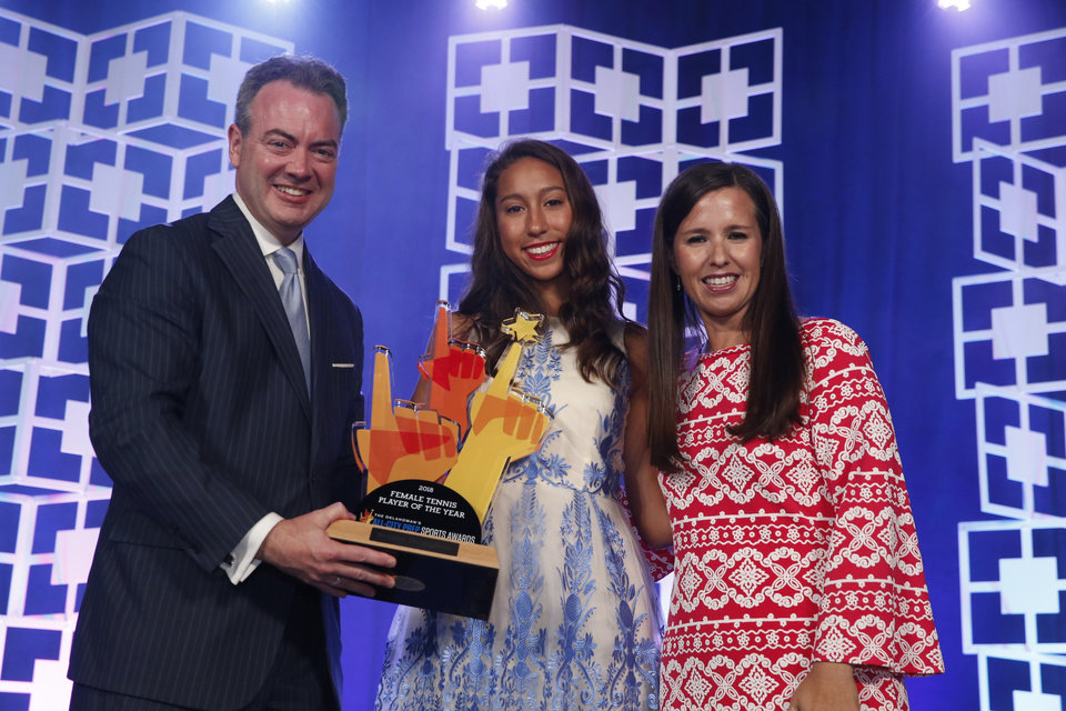 Photo - Oklahoman Publisher Chris Reen and sports columnist Jenni Carlson present the female tennis player of the year award to Brooke Thompson at the Oklahoman's All-City Prep Sports Awards, celebrating top high school athletes, at the Cox Convention Center on Tuesday, June 26, 2018 in Oklahoma City, Okla.  Photo by Steve Sisney, The Oklahoman