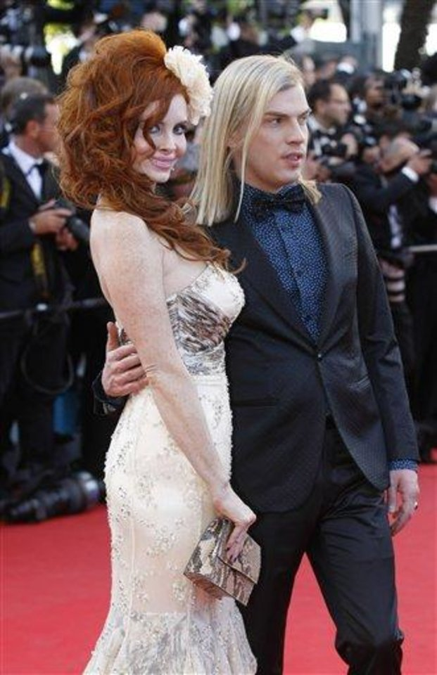 Photo - Phoebe Price, left, arrives for the opening ceremony and screening of Moonrise Kingdom at the 65th international film festival, in Cannes, southern France, Wednesday, May 16, 2012. (AP Photo/Lionel Cironneau)