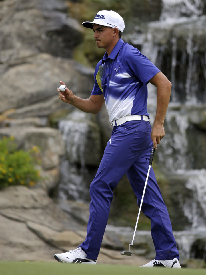 Photo - Rickie Fowler reacts after making a birdie on the 13th hole during the third round of the PGA Championship golf tournament at Valhalla Golf Club on Saturday, Aug. 9, 2014, in Louisville, Ky. (AP Photo/John Locher)