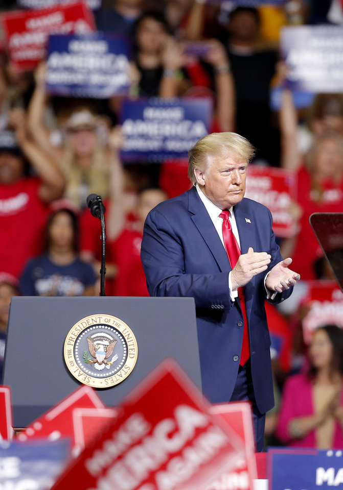 Photo - President Donald Trump reacts following his speech during a rally at the BOK Center in Tulsa, Okla., Saturday, June 20, 2020. [Sarah Phipps/The Oklahoman]
