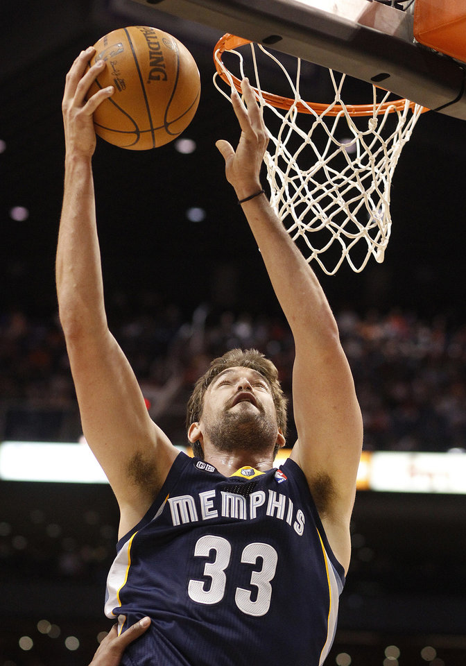Photo -   Memphis Grizzlies center Marc Gasol, of Spain, lays in a basket against the Phoenix Suns in the first quarter of an NBA basketball game Saturday, March 10, 20112, in Phoenix.(AP Photo/Paul Connors)