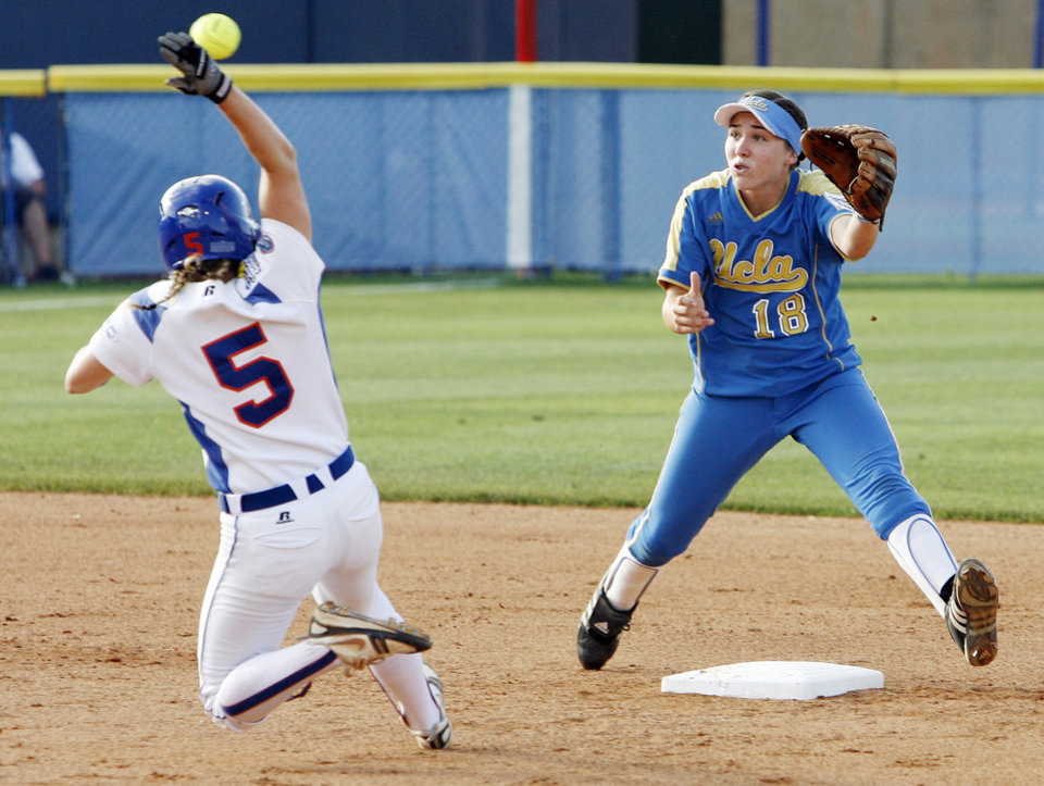 Florida's Kim Waleszonia (5) slides as she steals second base as UCLA's Monica Harrison (18) waits for the ball in the first inning during the softball game in the Women's College World Series between UCLA and Florida at ASA Hall of Fame Stadium in Oklahoma City, Saturday, May 31, 2008. BY NATE BILLINGS, THE OKLAHOMAN