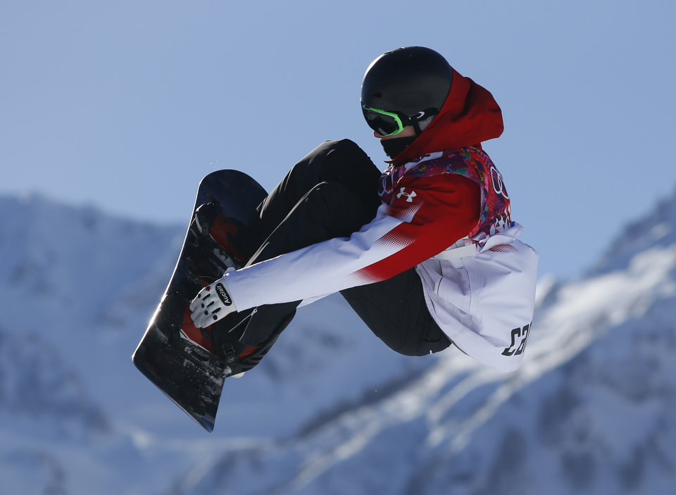 Photo - Canada's Maxence Parrot takes a jump during the men's snowboard slopestyle qualifying at the Rosa Khutor Extreme Park ahead of the 2014 Winter Olympics, Thursday, Feb. 6, 2014, in Krasnaya Polyana, Russia.  (AP Photo/Sergei Grits)