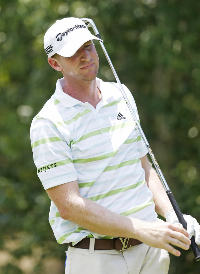 Photo - Vaughn Taylor watches his tee shot on the second hole during the second round of the Sanderson Farms Championship golf tournament, Friday, July 19, 2013 in Madison, Miss. (AP Photo/Rogelio V. Solis)