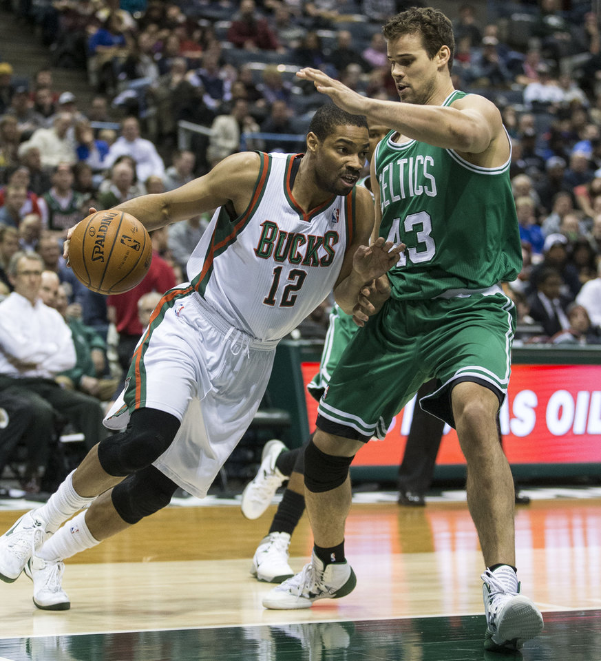 Photo - Milwaukee Bucks' Gary Neal (12) drives on Boston Celtics' Kris Humphries during the second half of an NBA basketball game, Monday, Feb. 10, 2014, in Milwaukee. (AP Photo/Tom Lynn)