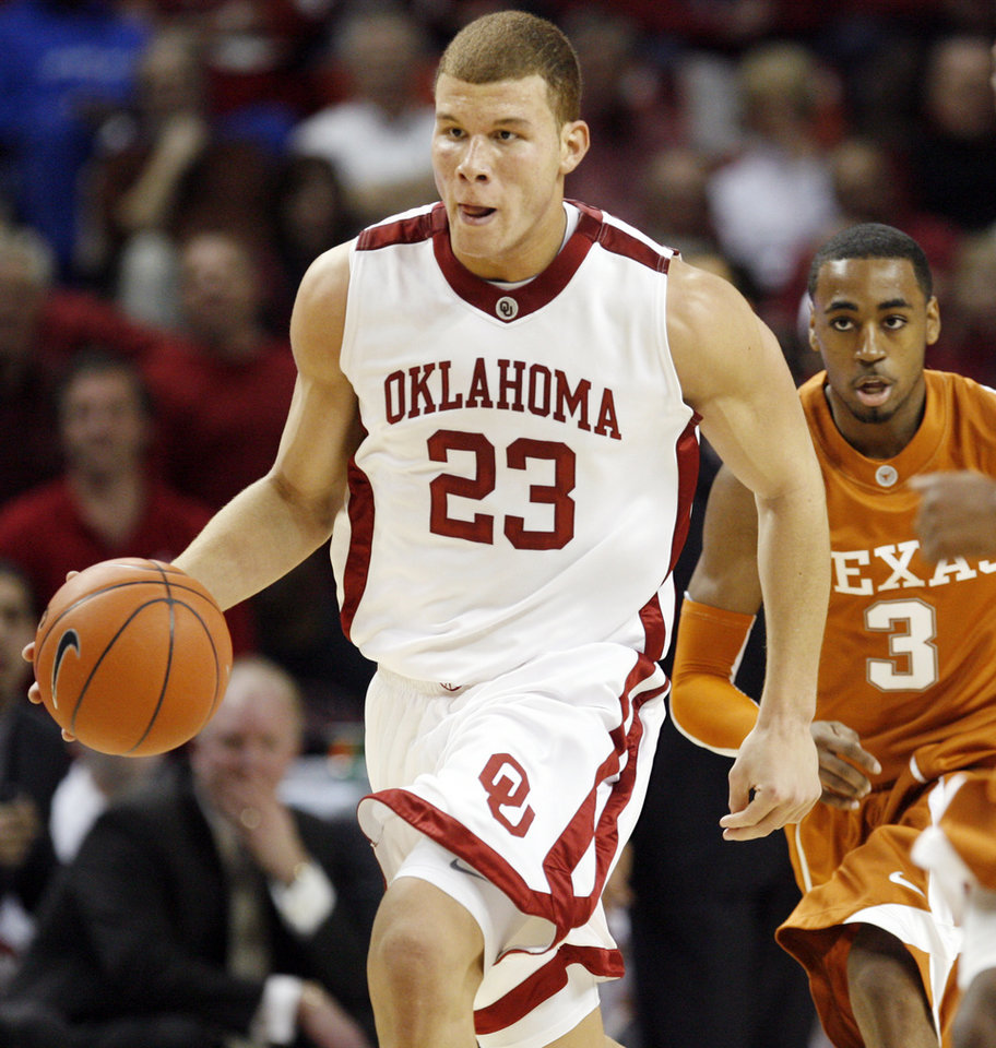 OU's Blake Griffin dribbles past UT's A.J. Abrams on a fast break in the first half during the Big 12 men's college basketball game between the University of Oklahoma and Texas at the Lloyd Noble Center in Norman, Okla., Monday, January 12, 2009. Photo By Nate Billings, The Oklahoman