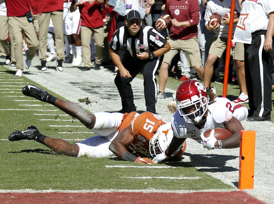 Photo - Oklahoma's CeeDee Lamb (2) is tackled by Texas defensive back Chris Brown (15) just before the end zone during the Red River Showdown college football game between the University of Oklahoma Sooners (OU) and the Texas Longhorns (UT) at Cotton Bowl Stadium in Dallas, Saturday, Oct. 12, 2019. [Sarah Phipps/The Oklahoman]