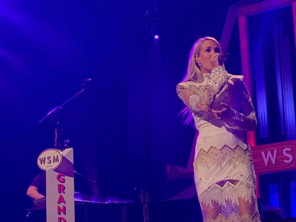 Photo - Carrie Underwood performs Tuesday night at the Grand Ole Opry in Nashville, Tennessee. [Opry photo by Photos by Hollo Photographics Inc.]