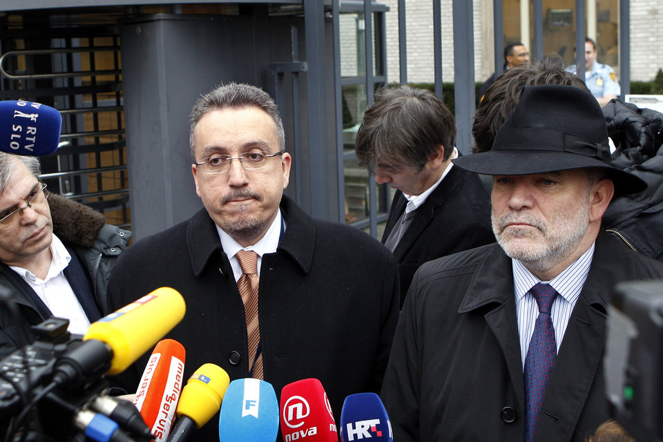 Photo -   Lawyer Luka Misetic, left, and Gotovina's American lawyer, Greg Kehoe, right, talk to the media outside the Yugoslav war crimes tribunal (ICTY) in The Hague, Netherlands, Friday, Nov. 16, 2012. The ICTY appeals judges overturned the convictions of two Croat generals on Friday for crimes against humanity and war crimes committed against Serb civilians in a 1995 military blitz. The decision, by a 3-2 majority in the five judge appeals chamber, is one of the most significant reversals in the court's 18-year history and overturns a verdict that dealt a blow to Croatia's self-image as a victim of atrocities, rather than a perpetrator, during the Balkan wars in the 1990s. (AP Photo/Bas Czerwinski)