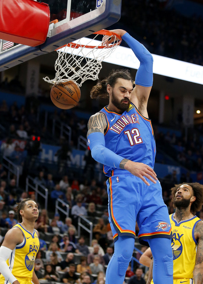 Photo - Oklahoma City's Steven Adams (12) dunks the ball during the NBA game between the Oklahoma City Thunder and the Golden State Warriors at Chesapeake Energy Arena,   Saturday, Nov. 9, 2019.  [Sarah Phipps/The Oklahoman]