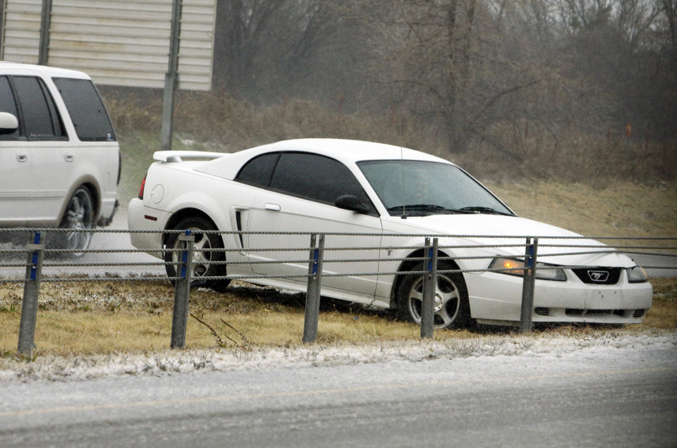 Photo -  Highway patrol and emergency personnel responded to several accidents on Interstate 35 between Johnson Road and the Goldsby exit at around 9 a.m, as rain, sleet, high winds and freezing temperatures moved into the area on Thursday, Dec. 24, 2009, near Norman, Okla.   Photo by Steve Sisney, The Oklahoman