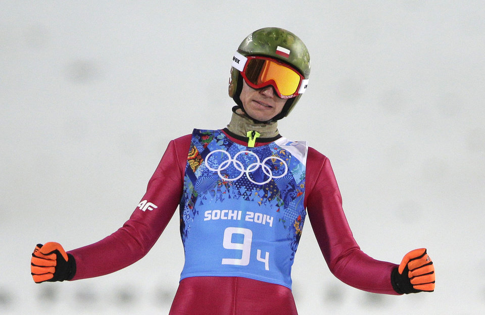 Photo - Poland's Kamil Stoch reacts after his first attempt during the ski jumping large hill team competition at the 2014 Winter Olympics, Monday, Feb. 17, 2014, in Krasnaya Polyana, Russia. (AP Photo/Matthias Schrader)