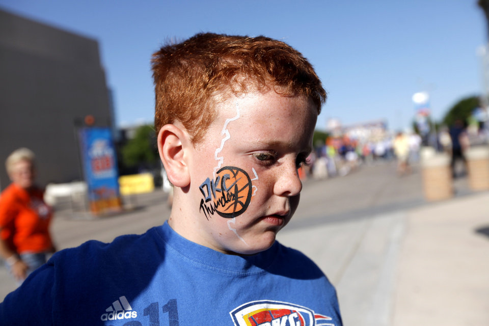 Photo - Luke Hamburger, 10, of Norman, Okla., has his face painted before game three of the Western Conference Finals in the NBA playoffs between the Oklahoma City Thunder and the San Antonio Spurs at Chesapeake Energy Arena in Oklahoma City, Thursday, May 31, 2012. Photo by Sarah Phipps, The Oklahoman