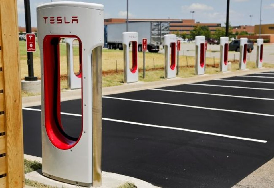 Photo -  Tesla opened a car charging station in 2015 on the west side of the OKC Outlets in west Oklahoma City. [CHRIS LANDSBERGER/THE OKLAHOMAN]