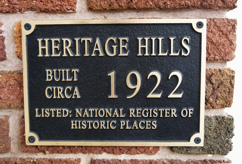 Photo - A plaque near the front door of the Hatfield home shows it to be listed on the National Register of Historic Places.