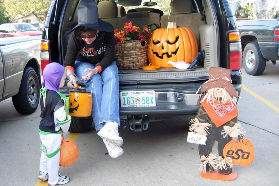 Alex Allen gets some candy at Janet Hudson�s OSU-themed �Trunk or Treat� during the Family Fall Festival at First Christian Church in Guthrie on Sunday, Oct. 28.<br/><b>Community Photo By:</b> Karen Allen<br/><b>Submitted By:</b> Karen,