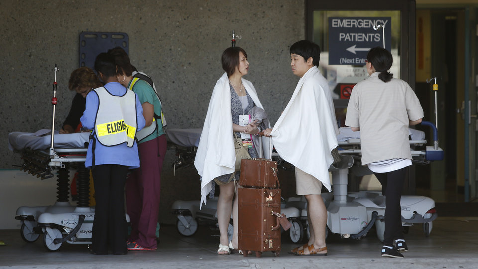 Photo - Passengers from Asiana Flight 214 are treated at San Francisco General Hospital after the plane crashed at San Francisco International Airport in San Francisco, Saturday, July 6, 2013. (AP Photo/Bay Area News Group, John Green)