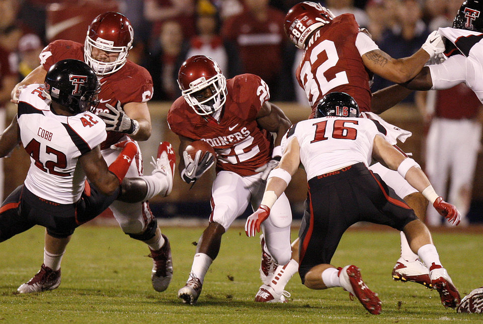 Photo - Roy Finch (22) runs during the college football game between the University of Oklahoma Sooners (OU) and the Texas Tech University Red Raiders (TTU) at Gaylord Family-Oklahoma Memorial Stadium in Norman, Okla., Saturday, Oct. 22, 2011. Photo by Bryan Terry, The Oklahoman