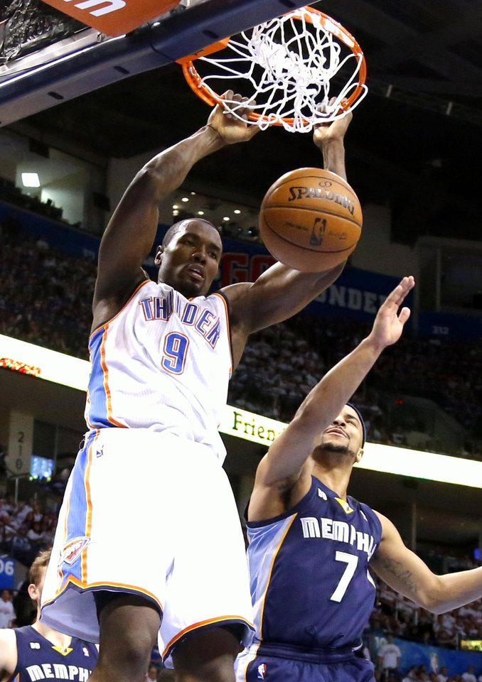 Oklahoma City\'s Serge Ibaka dunks the ball beside Memphis\' Jerryd Bayless during Game 2 in the second round of the NBA playoffs between the Oklahoma City Thunder and the Memphis Grizzlies at Chesapeake Energy Arena In Oklahoma City, Tuesday, May 7, 2013. Photo by Bryan Terry, The Oklahoman