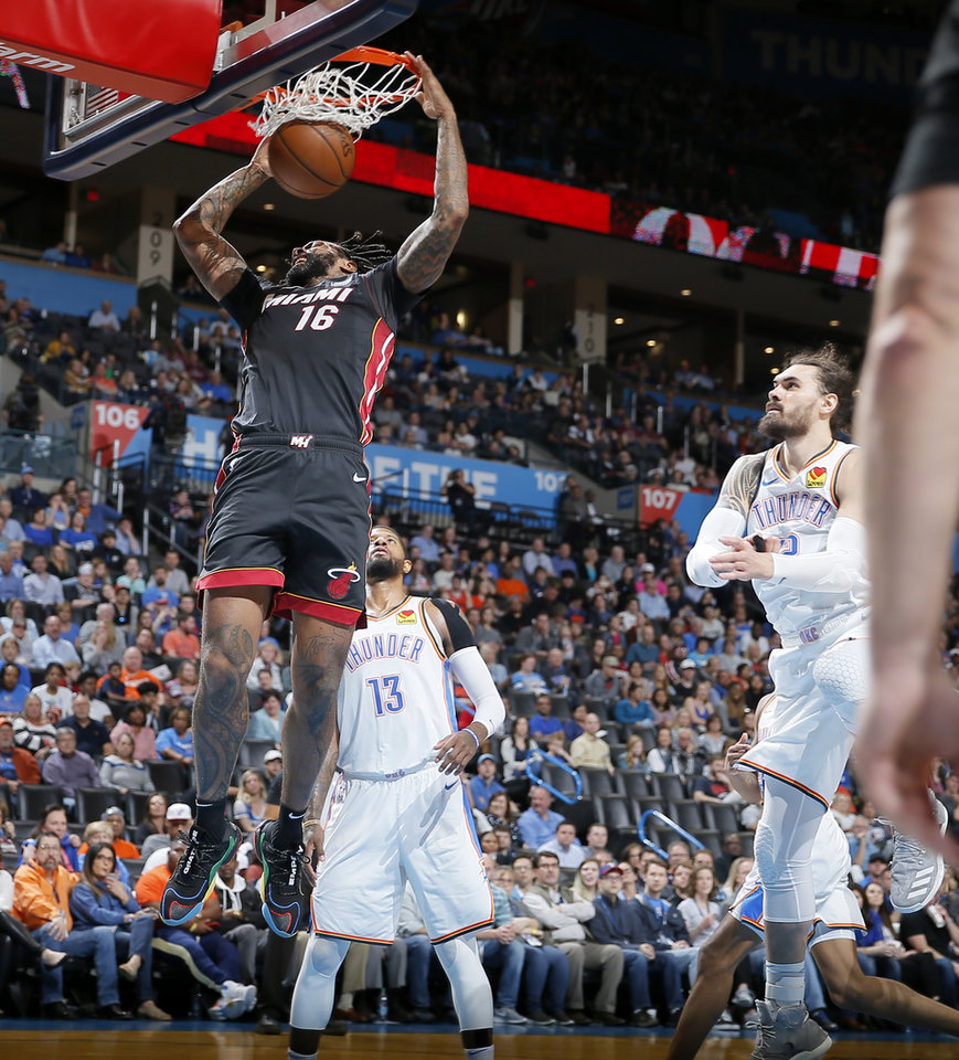 Photo - Miami's James Johnson (16) dunks beside Oklahoma City's Paul George (13) and Steven Adams (12) during an NBA basketball game between the Oklahoma City Thunder and the Miami Heat at Chesapeake Energy Arena in Oklahoma City, Monday, March 18, 2019. Miami won 116-107. Photo by Bryan Terry, The Oklahoman
