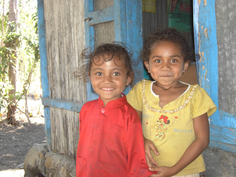 Two children grin at the camera in this World Neighbors photo from East Timor in southeast Asia. World Neighbors has helped communities there develop reliable water sources, diversify crops and more. <strong> - World Neighbors</strong>