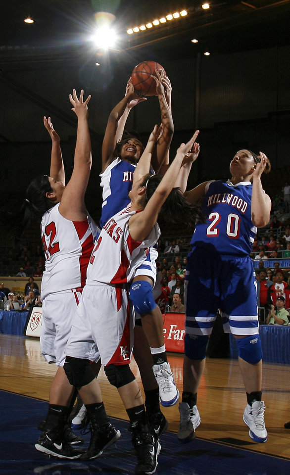 Photo - Millwood's JohVonna Mitchell (21)  and Marisha Wallace (20) fight Kansas' Brooke Panther (42), left, and Courtney Cowan (2) for a rebound in the final seconds of the girls 3A semifinal between MIillwood and Kansas at the State Fair Arena, Friday, March 13, 2009, in Oklahoma City. PHOTO BY SARAH PHIPPS, THE OKLAHOMAN