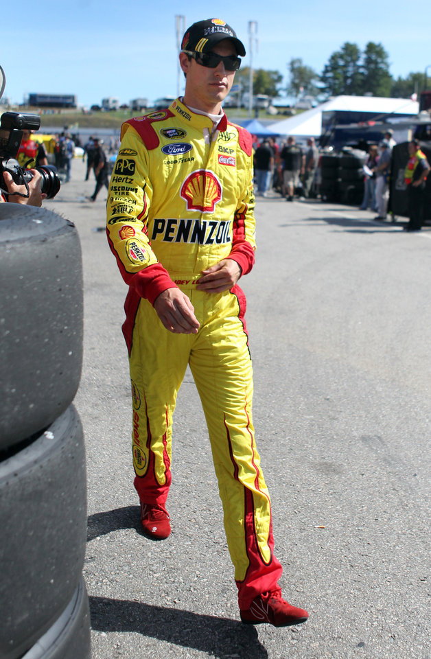 Photo - Joey Logano leaves his garage at the conclusion of practice for Sunday's NASCAR Sprint Cup Series auto race at New Hampshire Motor Speedway, Friday, Sept. 20, 2013, in Loudon, N.H. (AP Photo/Mary Schwalm)
