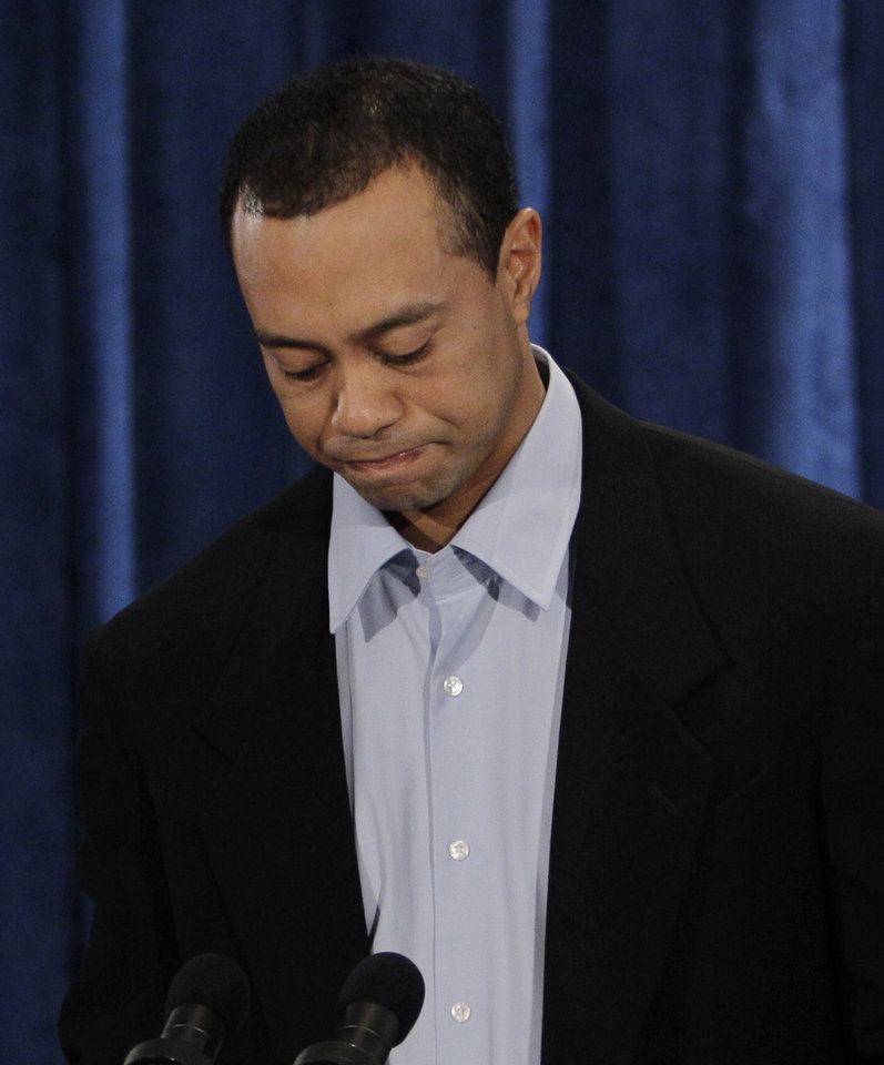 Photo - Tiger Woods during a news conference in, Friday, Feb. 19, 2010, in Ponte Vedra Beach, Fla. (AP Photo/Eric Gay) ORG XMIT: FLEG105