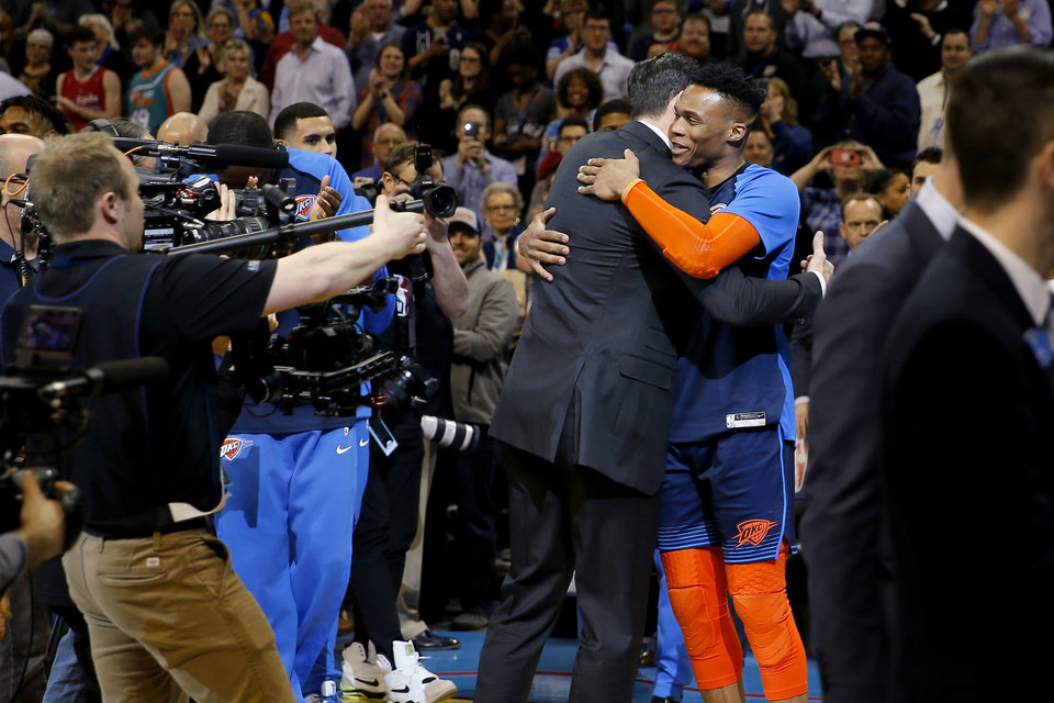Photo - Nick Collison hugs Oklahoma City's Russell Westbrook after a ceremony to retire his jersey number before an NBA basketball game between the Oklahoma City Thunder and the Toronto Raptors at Chesapeake Energy Arena in Oklahoma City, Wednesday, March 20, 2019. Photo by Bryan Terry, The Oklahoman