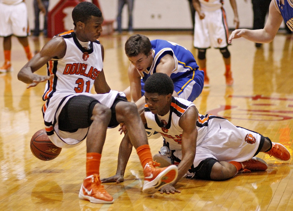 Dydrell Post of Douglass, left, and Stephen Clark go for the ball beside Piedmont's Hunter Kirton during a Class 4A boys basketball state tournament game in Midwest CIty, Okla., Thursday, March 8, 2012. Photo by Bryan Terry, The Oklahoman