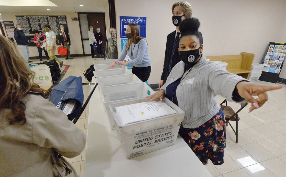 Photo - Marian Collin Franco, 20, helps collect provisional ballots at the Erie County Courthouse on Election Day, Tuesday, Nov. 3, 2020, in Erie, Pa. (Greg Wohlford/Erie Times-News via AP)