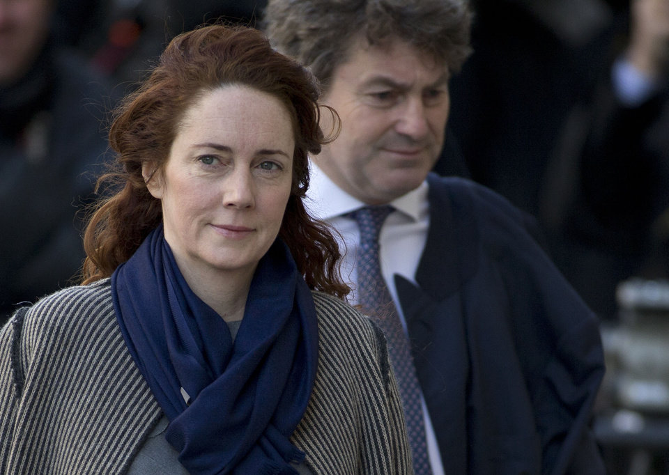 Photo - FILE - This is a  Friday, Feb. 21, 2014 file photo of  Rebekah Brooks former News International chief executive and her husband Charlie Brooks, arrive at the Central Criminal Court in London where they appear to face charges related to phone hacking. Former News of the World editor Andy Coulson has been convicted of phone hacking, on Tuesday June 24, 2014   but fellow editor Rebekah Brooks was acquitted after a months long trial centering on illegal activity at the heart of Rupert Murdoch's newspaper empire. (AP Photo/Alastair Grant)